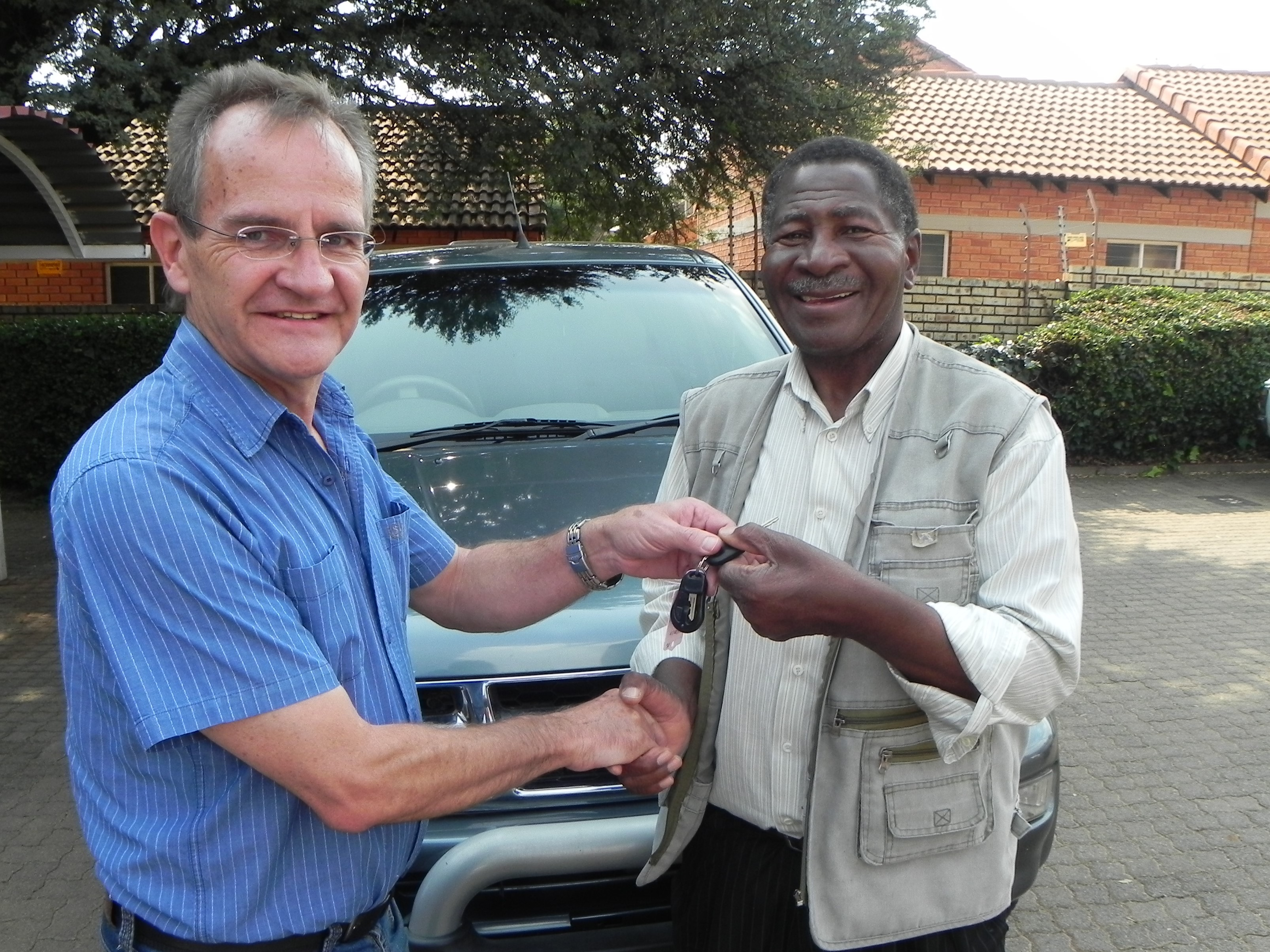 Lukas Handing Over The  Keys To The Vehicle Donated To Pastor Nonyane